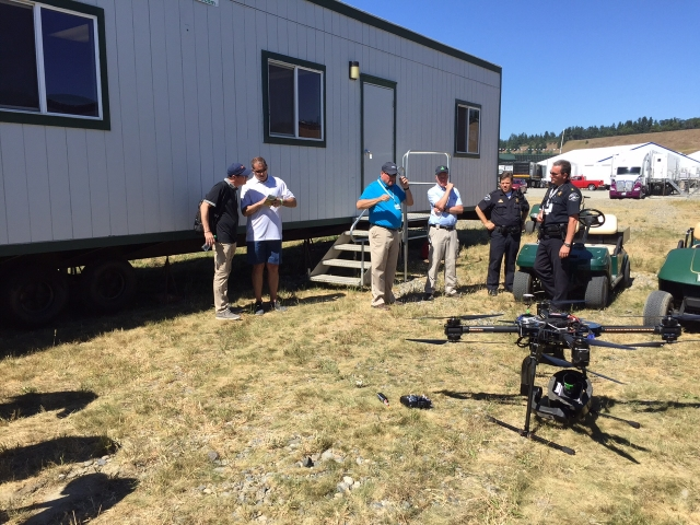 Getting the big drone prepped and ready while the local police look on. It took a lot of FAA paperwork and approvals to be allowed to fly at Chambers Bay.